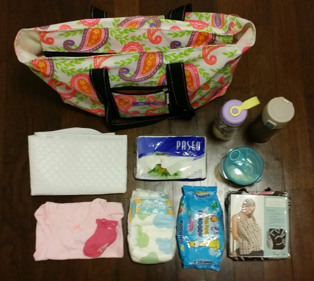 Some of what's in our diaper bag! Not forgetting the rest as well as mummy/daddy's stuff too. *phew*