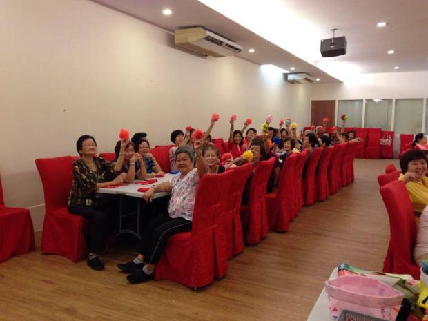 Happy faces from the senior folks at a community workshop - showing off their flower power!