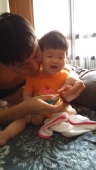 baby V cutting nails
