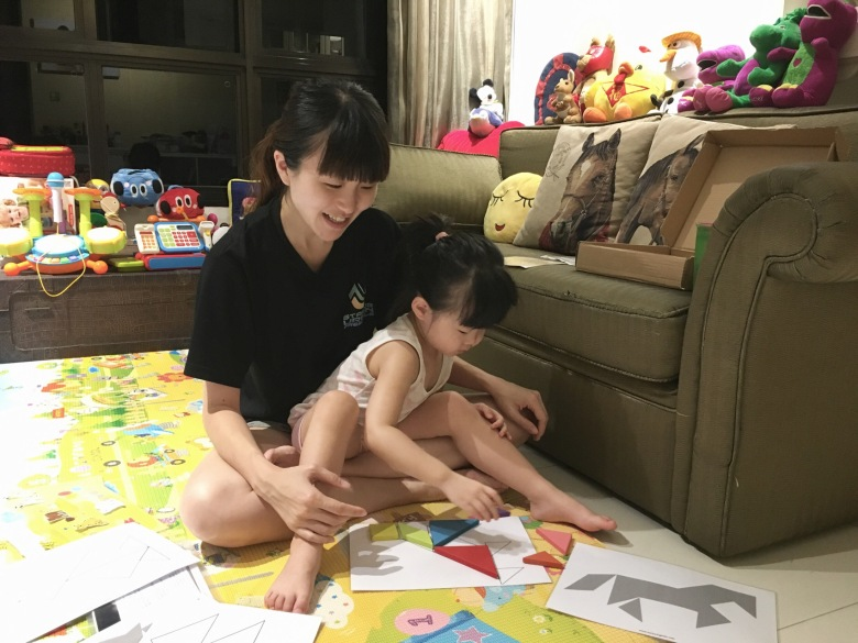 mother and daughter play tangrams singapore